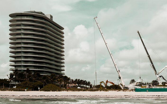 Eighty Seven Park next to the collapsed Champlain Towers South (Getty)